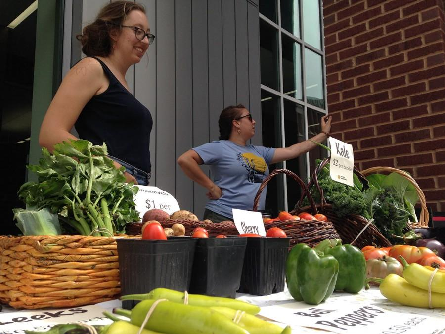 Marni Kaldjian and Kate Beaton mind the Centennial Campus Market outside Centennial Hall. The market is open from 7 a.m. to noon every Thursday until mid October.