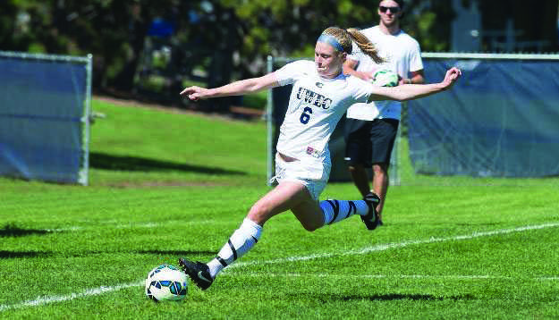 Senior captain Ashley Seymour attempts a cross during a game at Bollinger field.