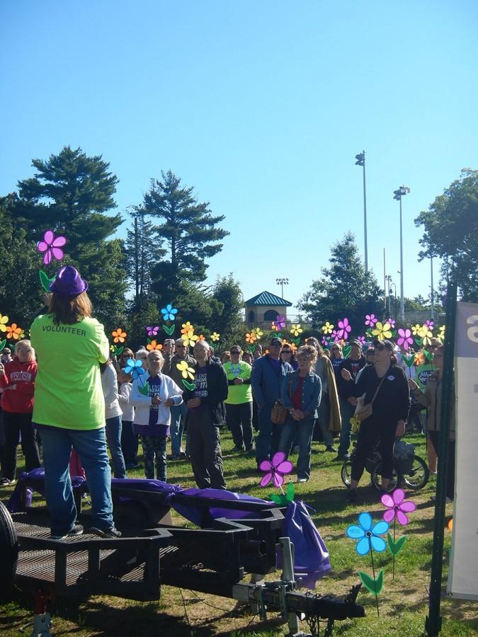 Walkers hold up their Promise Garden flowers to show their support.