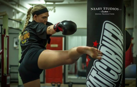 Senior marketing major Jennifer See is in the peak of her training camp for her mixed martial arts fight Oct. 3 at the Eau Claire Indoor Sports Center. She is also a WWE prospect and will be attending Monday Night Raw later in October to learn more about her future with the company. (SUBMITTED)