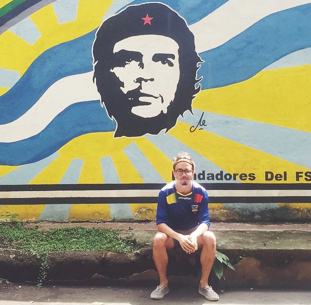 Taiveaho sits in front of a mural outside a revolutionary mural in Leon, Nicaragua in June.