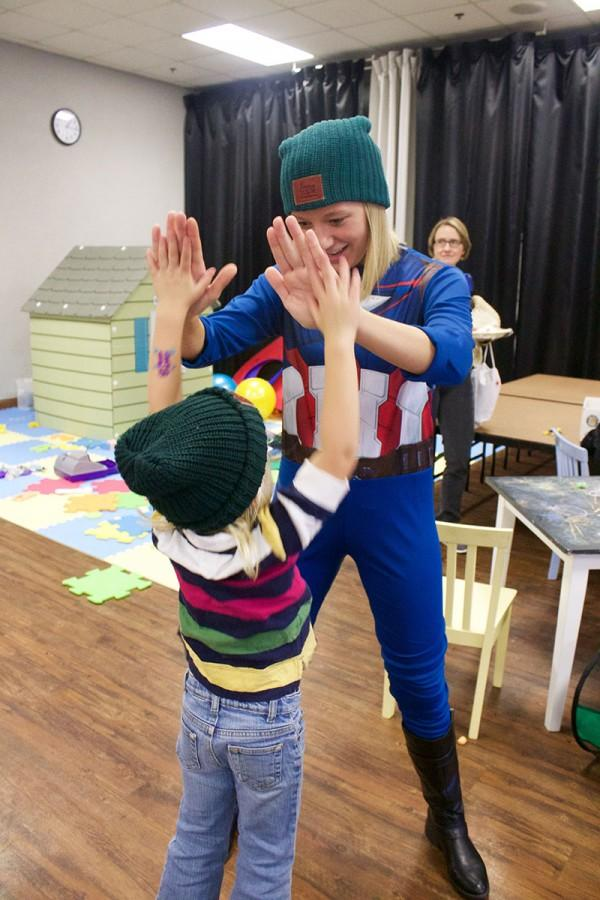 Michelle Cremers high-fives a camper at Joshua's Camp.