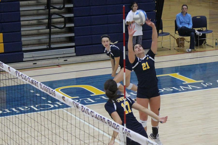Senior Jenna Smits sets the ball up for the team's hitters Emily Miller (top) and Kelly Riesgraf (bottom) in a match against Northwestern—St. Paul (Minn.). The home match was part of the Sandy Schumacher memorial tournament and part of the Blugolds' current nine-game winning streak.