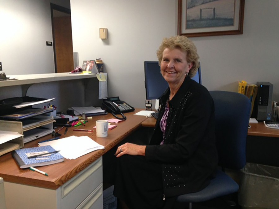 Saying goodbye with a smile: Susan Brumberg-Schaefer poses at her desk during her last week as the secretary for the University Police.