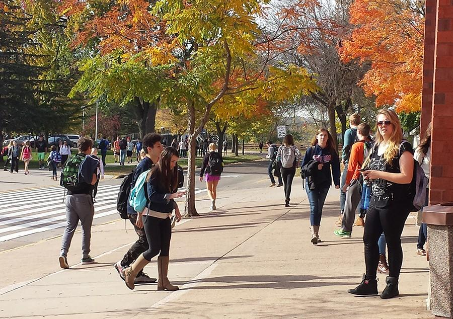 Varieties of students come and go outside Hibbard Hall at UW-Eau Claire where admissions is working to have the university be composed of 20 percent colored students.