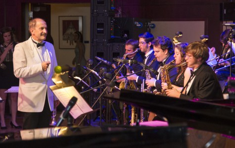 Director of Jazz studies and UW- Eau Claire trumpet Professor Robert Baca directs the band as they perform.