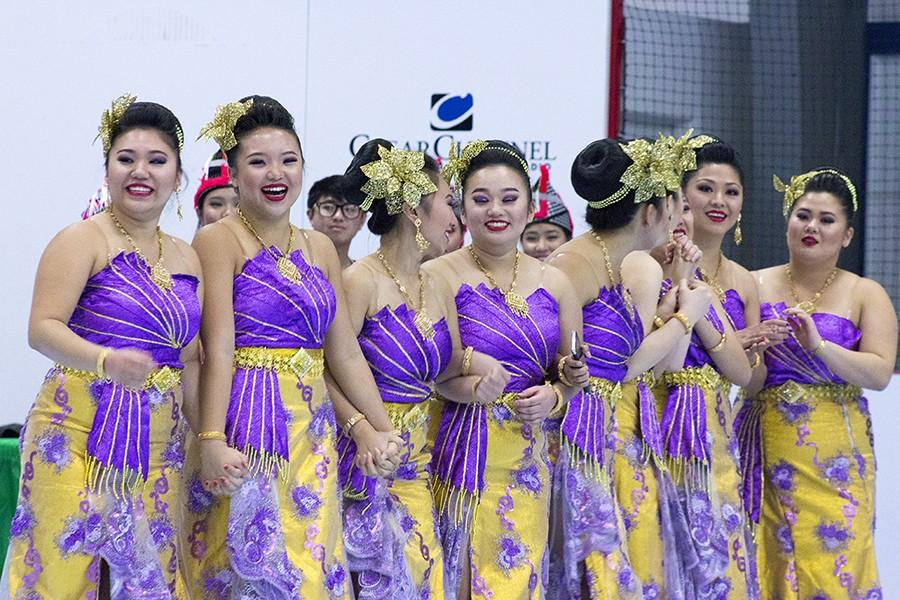 Dancers await results of competition Sunday afternoon at Hmong New Year celebration.