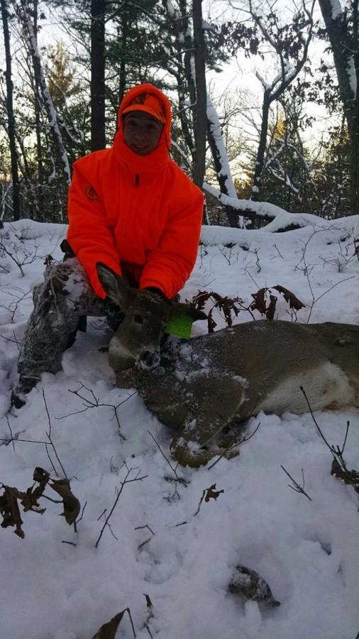 Emily Day poses with her newly prized deer from opening weekend.