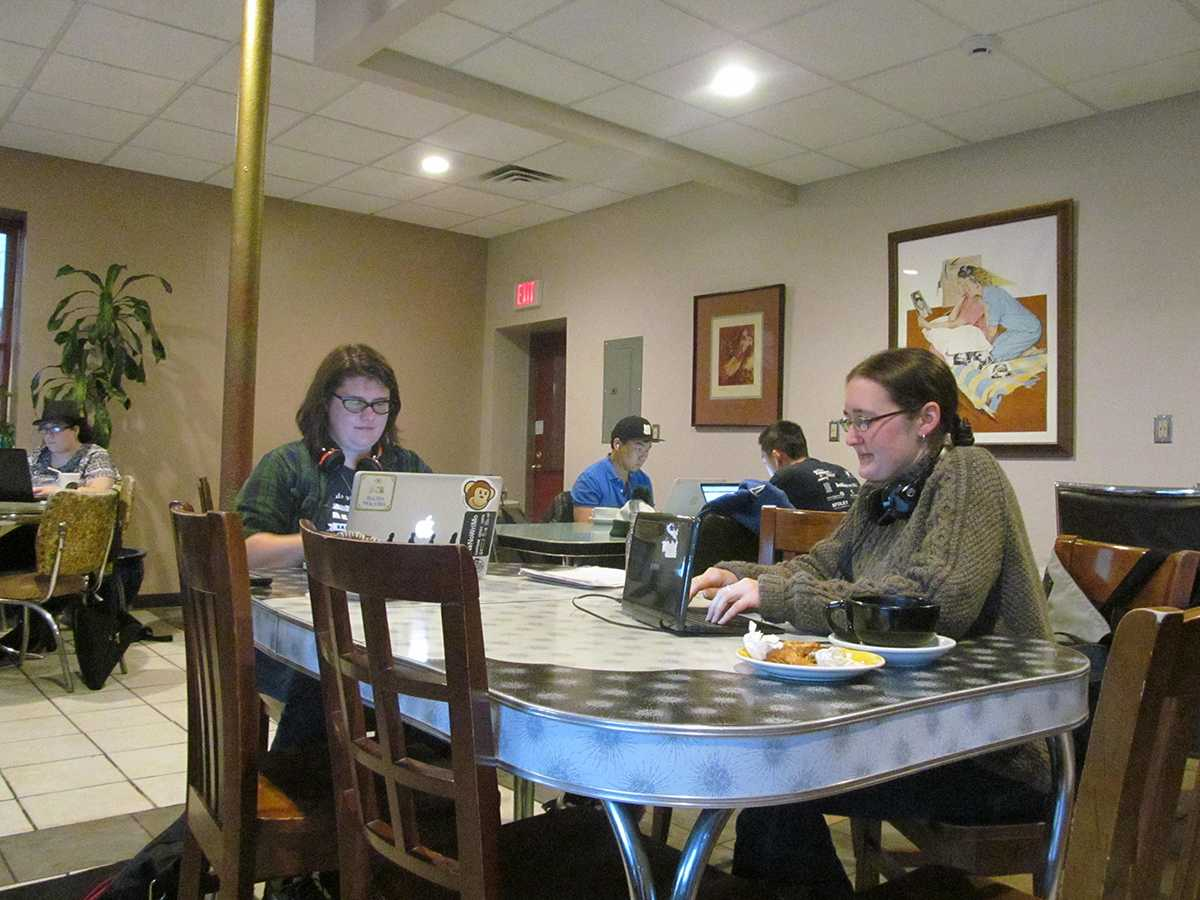 Aimee Johnson and Cheryl O'Brien write during National Novel Writing Month during a write-in at  Racy's.