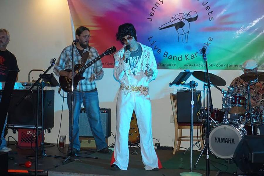 Senator Colton Ashley dressed as Elvis Presley and singing his music with live karaoke band Jenny and the Jets at The Plus on a Monday night after a Student Senate meeting.
