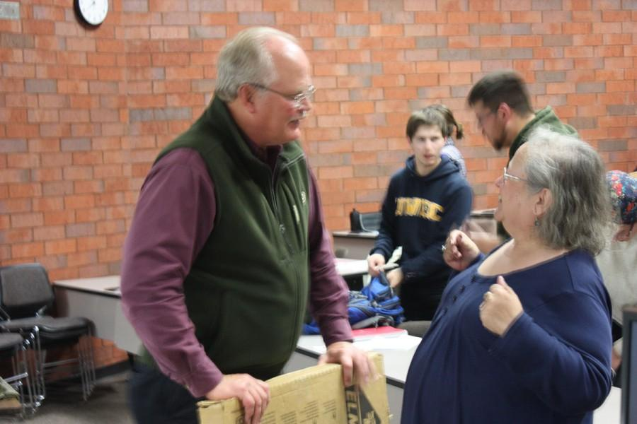 Former State SenatorDale Schultz, R-Richland Center, stays late after his presentation to speak with Margaret Cameron of Eau Claire about education.