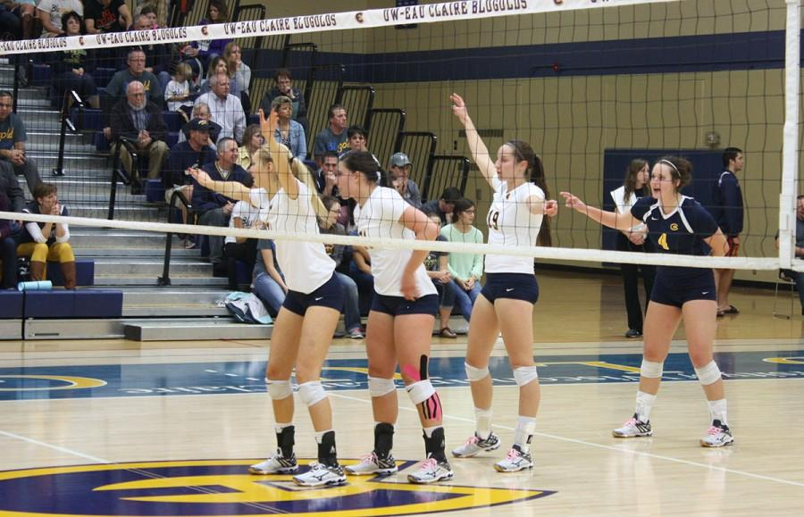 Keagan Kinsella, Jenna Smits, Hannah Theisen and Talia Jaskulske await the serve against the Pointers.