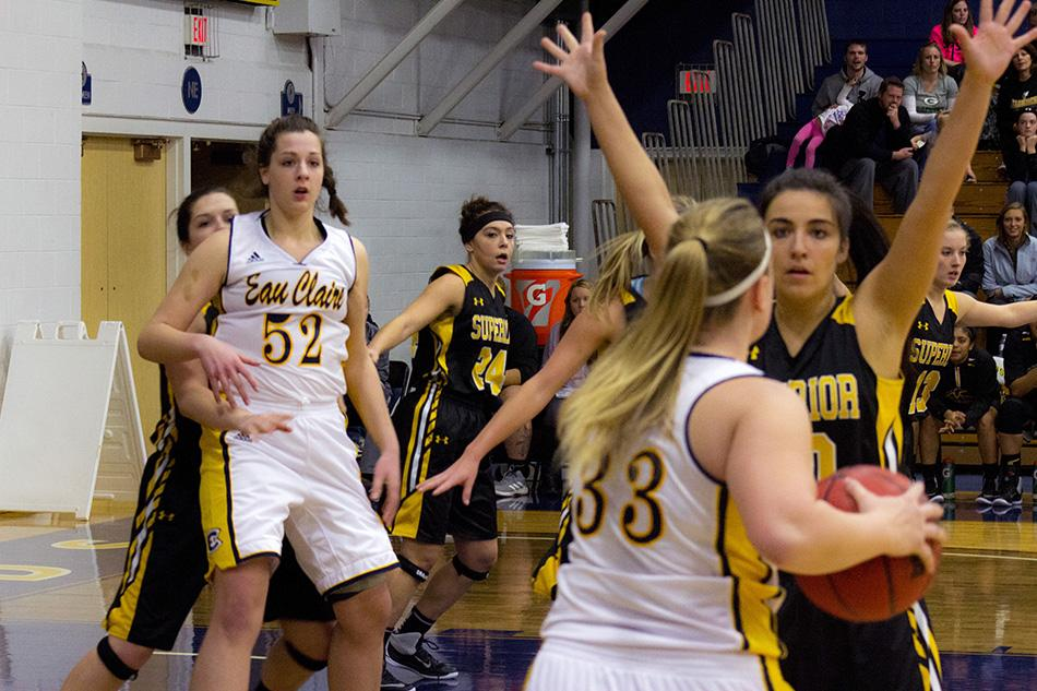 Junior Bree Meier looks to Sophomore center Erin O'Toole as she posts up in the paint against UW-Superior Saturday night in Zorn Arena.
