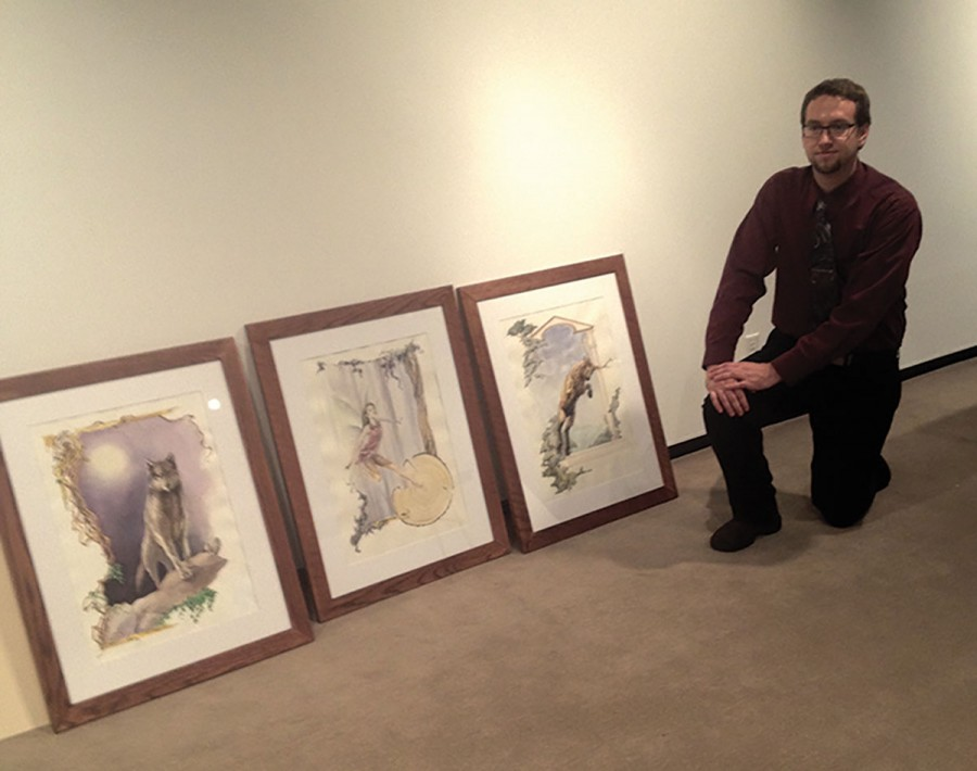 Senior art student Michael Gherke stops to strike a pose while preparing his work  for the Bachelor of Fine Arts senior Exhibition, debuting Dec.4 at the Foster Gallery in Haas.