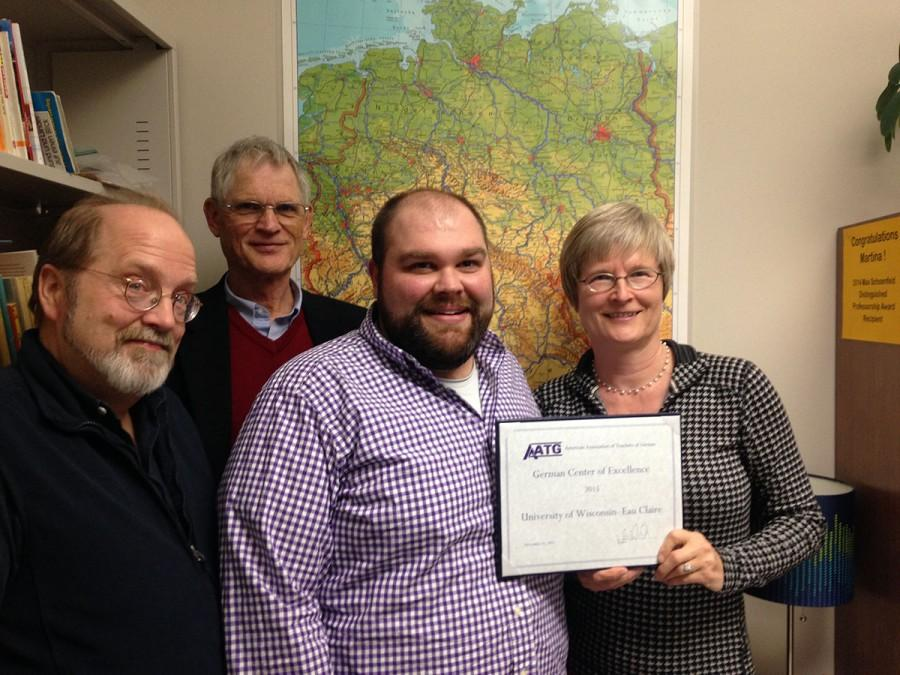 Jefford Vahlbusch, Johannes Stroschänk, Josh Brown and Martina Lindseth present the Center of Excellence designation awarded to the UW-Eau Claire German program this year. Lindseth and Brown received the award Nov. 21 in San Diego, California, at the American Council on the Teaching of Foreign Languages Annual Convention and World Languages Expo.