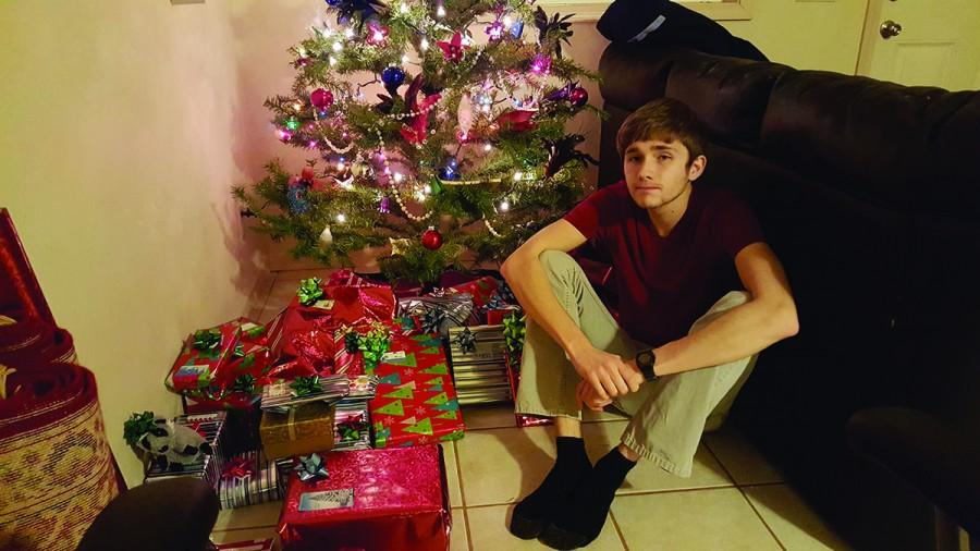Copy Editor Brian Sheridan sits among the presents he and his roommate have wrapped for their friends and family.