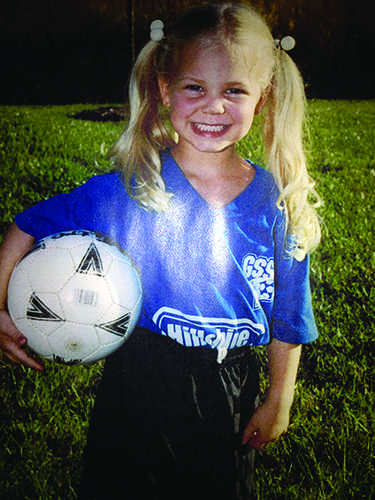 Posing with a soccer ball at the age of four, Colette began playing soccer which carried through two years of being a Blugold Athlete, setting the stage for her active lifestyle.
