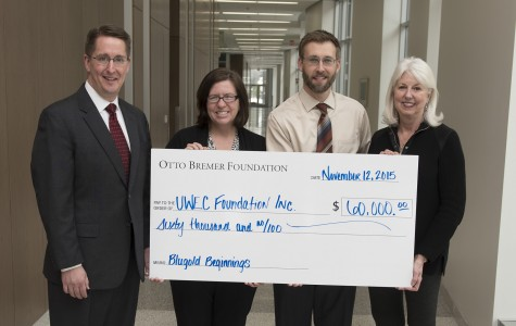 Blugold Beginnings accepts the Otto Bremer Trust grant. Pictured: James Lahti, Otto Bremer Trust market president; Jodi Thesing-Ritter, UW-Eau Claire executive director for diversity and inclusion; Matt Flannery, Otto Bremer Trust senior retail sales manager; and Betsy Kell, advisory committee chair for Blugold Beginnings