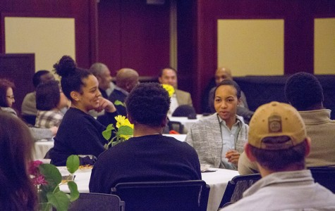 The Black Student Alliance presented the Black History Month dinner reception Feb. 5, which honored African American veterans. BSA executive members Laura McDew, left, and Kiana Veal engage in conversation at the reception.