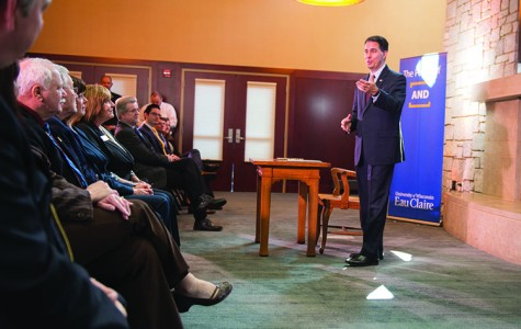 Gov. Scott Walker stopped by UW-Eau Claire monday to sign a bill that requires higher education institutions to mail students annual updates on their student loans. He addressed a group of about 30 in the Alumni Room of the Davies Center.