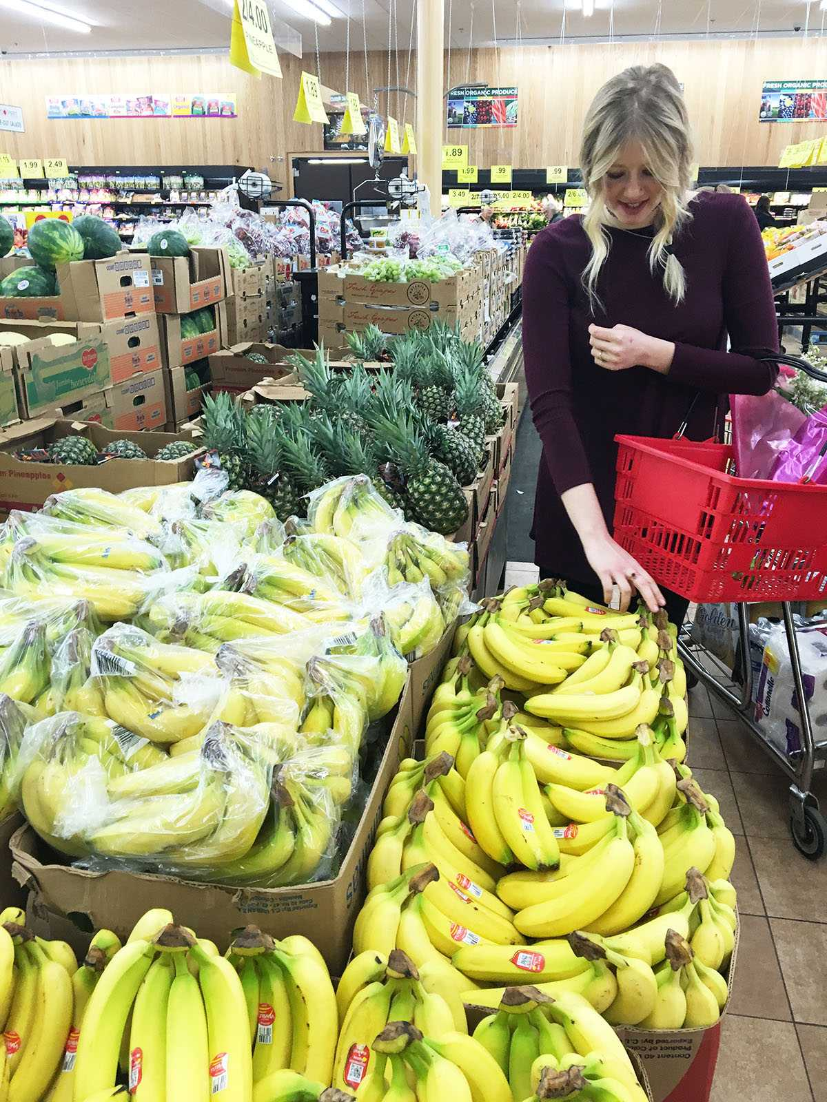 """Hannah Larson grocery shopping at Woodman's for her next recipe. Larson started the blog """"You Thyme"""" to provide fellow college students with recipe and self-care advice."""