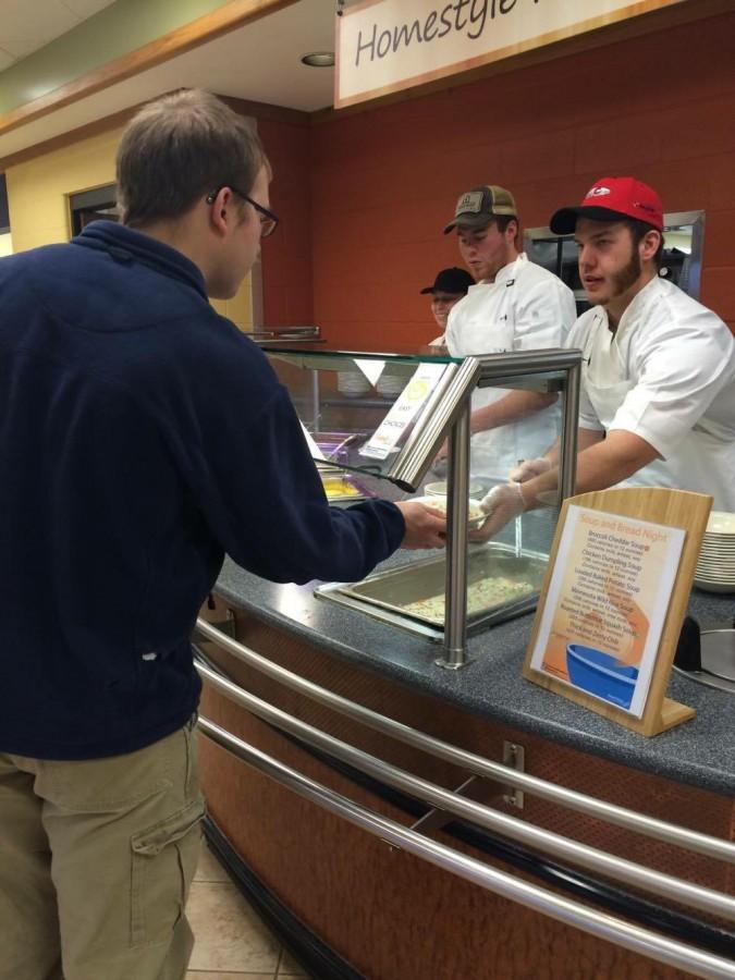 Student volunteers serve soup and bread instead of usual dinner choices.