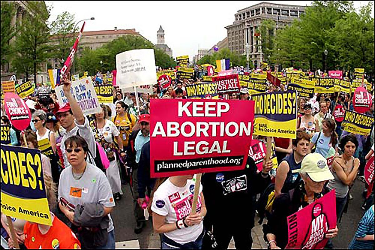 A group of pro-choice protesters gather in Madison to advocate for reproductive rights.