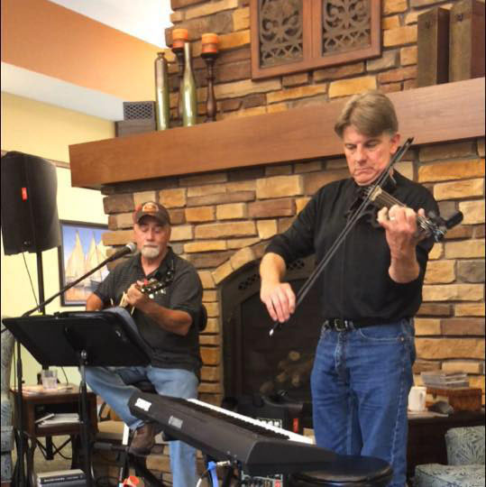 The two-man band Two Frets Up performed at 7:30 p.m. Friday night at Acoustic Café, covering bands such as The Eagles, Garth Brooks and Darius Ruckers. The duo combined the sounds of jazz, blues and soft country rock.