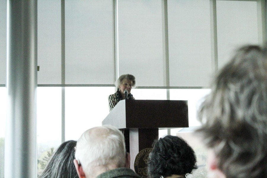 The+audience+listens+closely+as+Joan+Christopherson+Schmidt+reads+the+poem+she+selected+in+honor+of+Frost.+Schmidt+was+one+of+13+readers+to+recite+a+poem.+