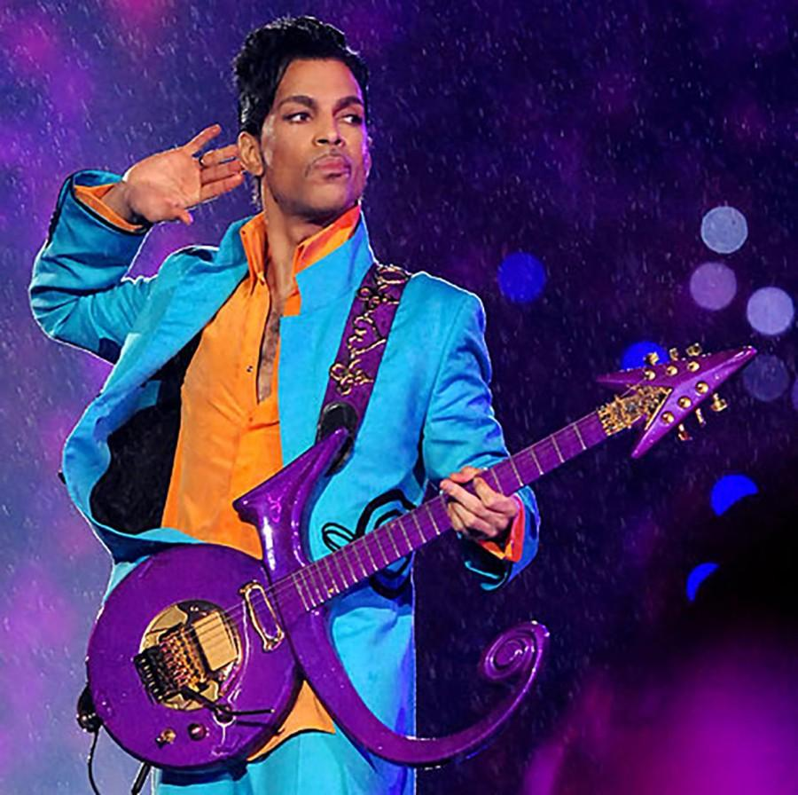 Prince listened to an audience roar while jamming on a purple guitar.