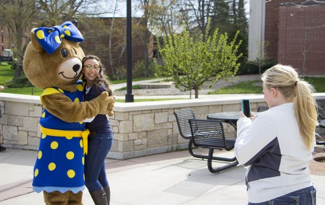 Junior CSD student Emmy Gerome poses for a photo with the Autism Speaks mascot at the 11th annual 24-hour event for the Epsilon Alpha chapter of Alpha Xi Delta.