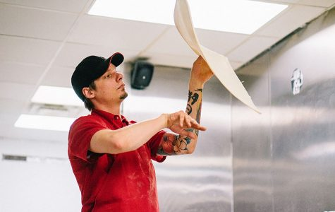 "National pizza making contestant Nick Kotecki prepares for the ""Skin Sprints"" competition this June by making pizzas as quickly as he can at the local Toppers Pizza."