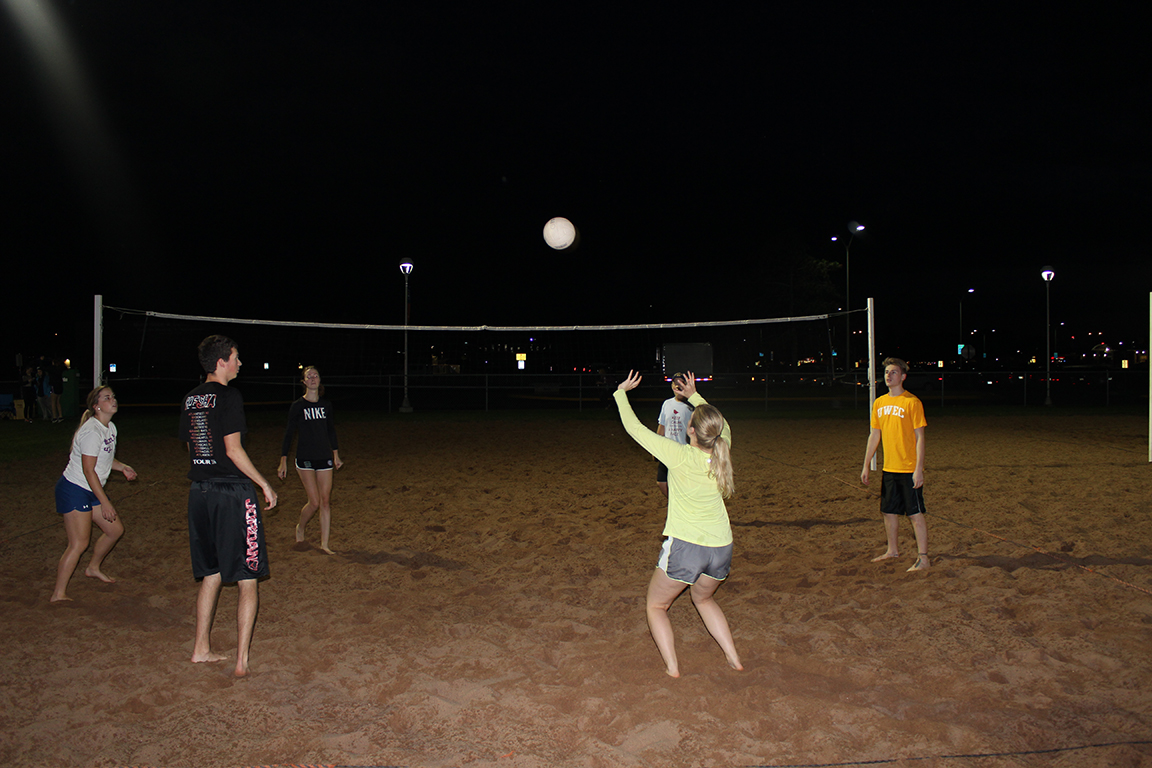 """Team named """"Sets on the beach"""" warm up on the Tower's field sand volleyball court before their game at 8:00 p.m. on Tuesday."""