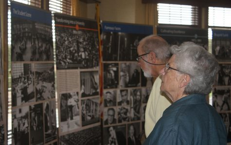 UW-Eau Claire alumni hailing from a host of decades and points on the map spent early Wednesday afternoon viewing the university's centennial displays to get a grasp of the past, before Chancellor Schmidt gave a presentation outlining the future. (Gabriel Lagarde)