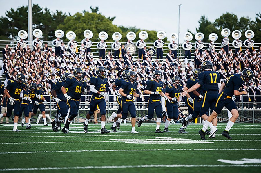 The Blugold Marching Band helps motivate the football team and excite the fans.