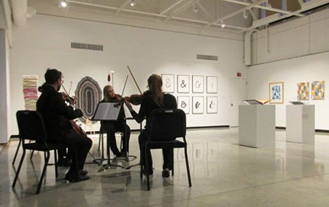 The Rococo String Quartet performed amidst alumni art in the Foster Gallery.