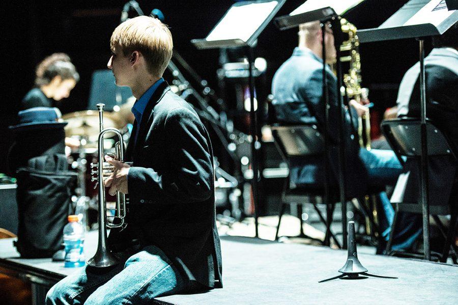 Kristofer Bergh, senior trumpet performance student backstage warming up before Jazz 1 took the stage.