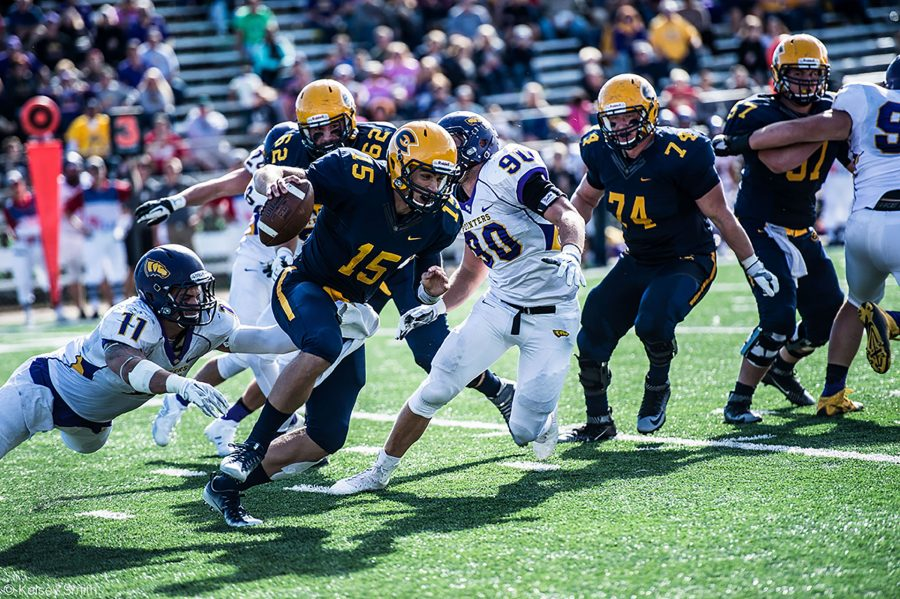 Quarterback JT Denhartog escapes the UW-Stevens Point defense, picking up yards for the Blugolds.
