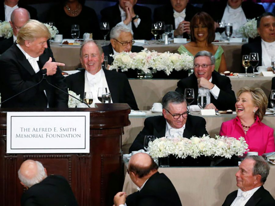 Hillary Clinton laughs at Donald Trump's jokes about her at the Alfred E. Smith Dinner