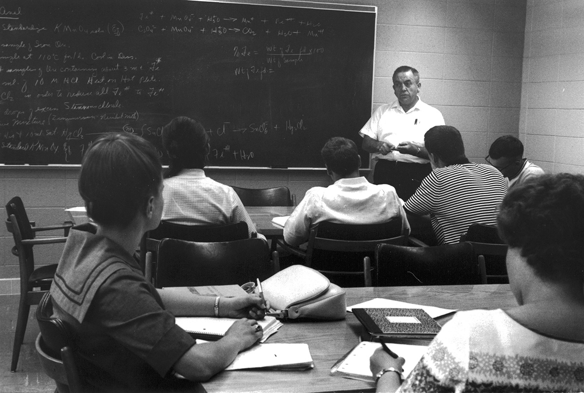 Students in a math class, circa 1970. The Student Success Center offers Math Lab for students who need help in their mathematical studies.