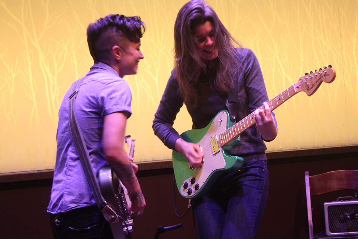 Guitarist Jen Trani, left, and Maryleigh Roohan play in tandem during an impromptu jam session in the first set. Roohan described her partnership with Trani as a friendly game of one upmanship where both musicians benefited.