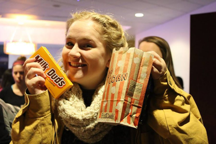 Lexi Uhlenbeck enjoys Milk Duds and popcorn at last weeks Eau Queer Film Festival. (SUBMITTED)
