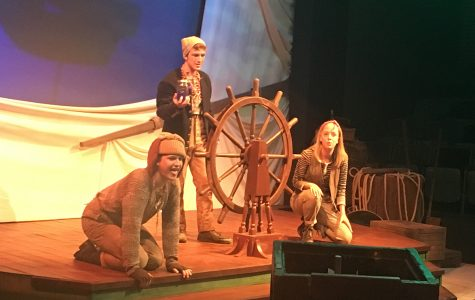 """Joey Sletner, Tristen Wilkes and Emily Elliot perform in the shipwrecked scene of the Music and Theatre Department's newest production """"Shipwrecked!: The Amazing Adventure of Louis de Rougemont As Told By Himself."""""""