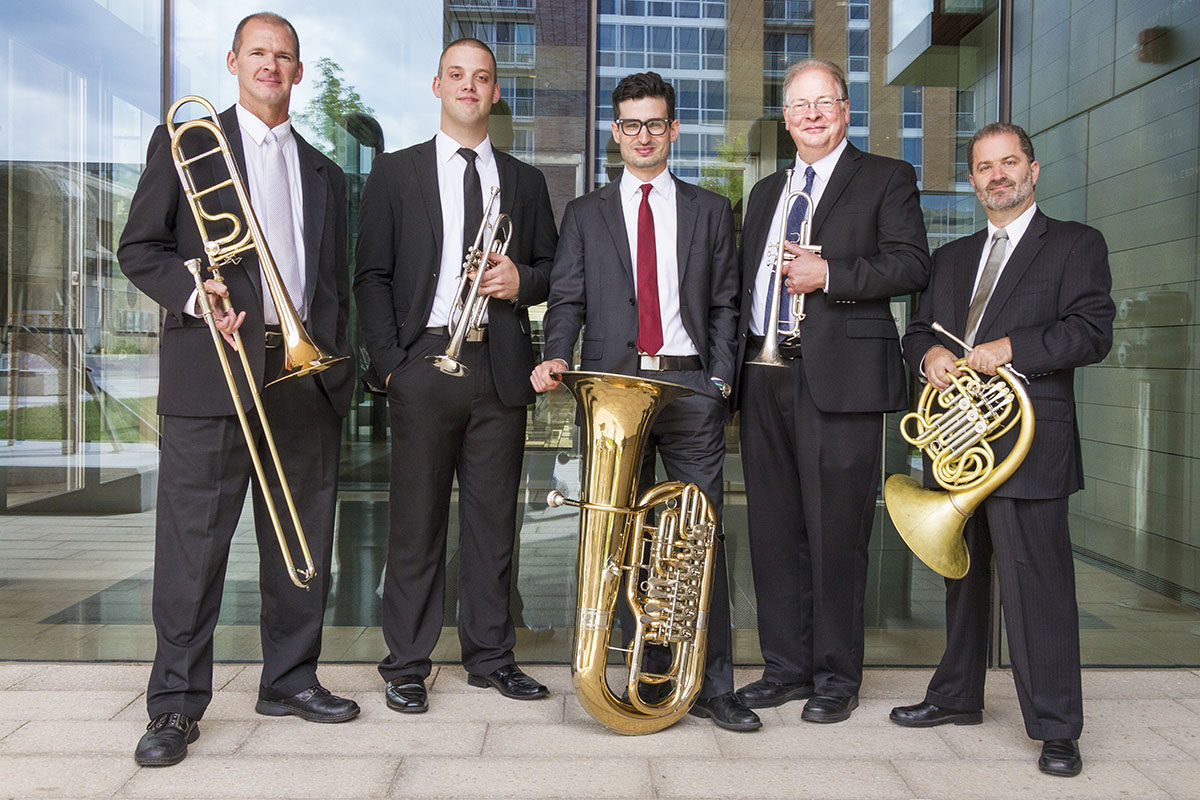Each of the members of the Wisconsin Brass Quintet pose with their instruments.