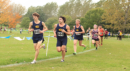 Matt Cyra, the third Blugold runner pictured on the right, said the team worked well together during the UW-Oshkosh Invitational on Saturday at Lake Breeze Golf Course.