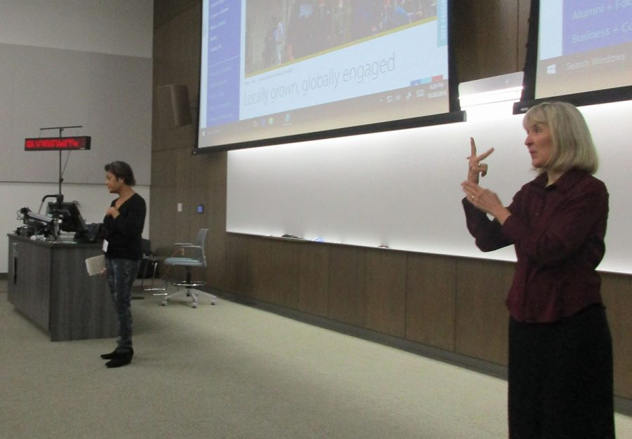 """Author of """"Prison Baby: A Memoir"""" stands beside a sign language interpreter. Jiang-Stein spoke about labels as an invisible disability and stereotypes carried against incarcerated women."""