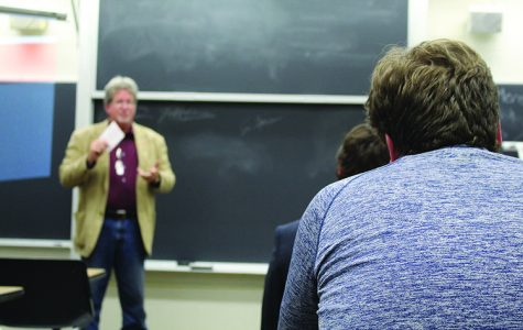 Students sit during a College Republicans meeting as Wisconsin State Assembly candidate Bill Ingram, pictured background, speaks. (Lara Bockenstedt)