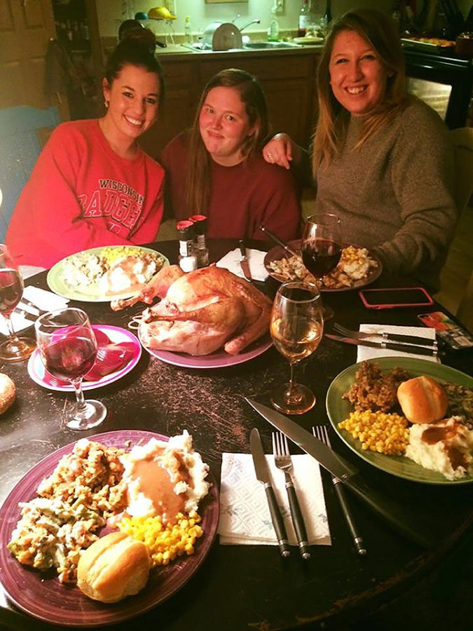 Staff Writer Hailey Novak celebrates Friendsgiving with roommates Jordan Conlon and Coral Managan at their college apartment around the holidays.