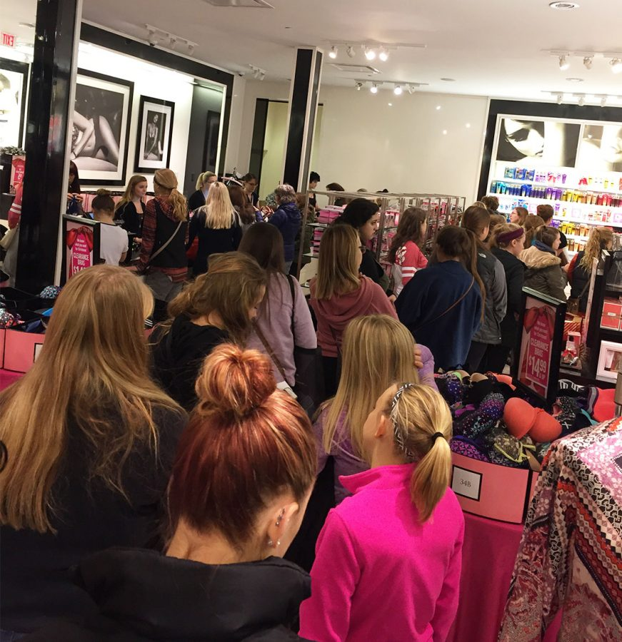 Women of all ages wait in a long line to purchase items on sale at 6 a.m. during Black Friday at Victoria's Secret.
