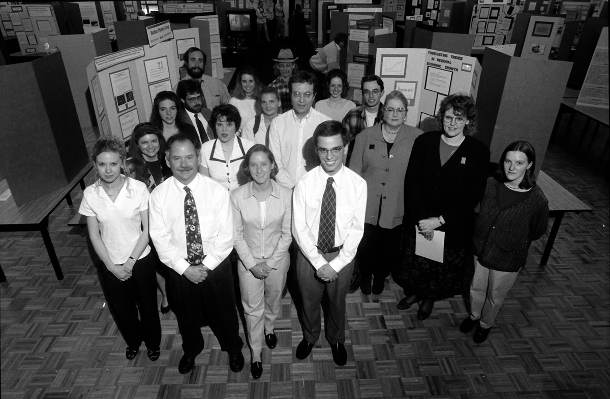 Students in the Department of Economics conduct research alongside their professors. Shown here are students with their research projects on Research Day in 1997.